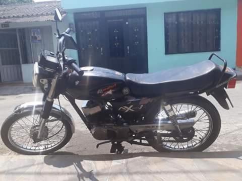 Moto Ax100 Solo Targeta! con Recamara